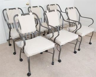 """Rolling irons chairs with plastic seat coverings. 34""""H x 21""""W x 17.5""""D  Good condition."""