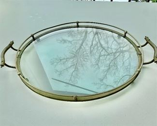 $45 - Two-handled oval glass and metal tray with center etching; 1 3/4 in. (H) x 19 in. (L, including handles) x 12 in. (W)