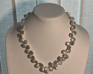 Pearl necklace with silver clasp - around 21 inches long - 100 dollars