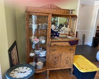 Tiger oak China cabinet with beveled glass mirror