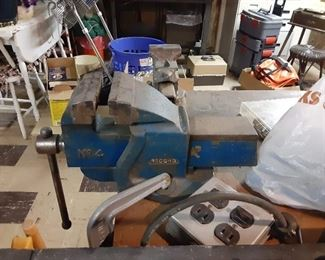 Several bench vises antique heavy duty