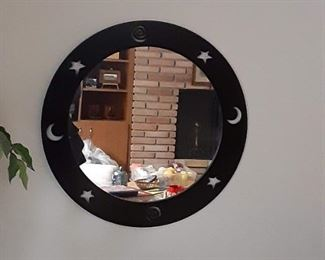 Moon and stars around mirror