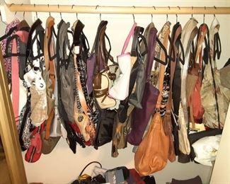 Lots of ladies designer handbags