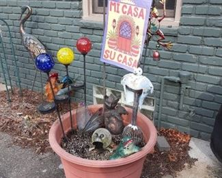 Lots of fun garden art decorations and statuary