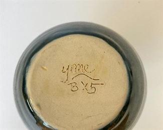 Signed pottery vase.  YMC