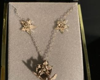 Silver necklace and earrings.