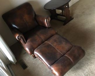 NICE LEATHER CHAIR AND CURVED OTTOMAN