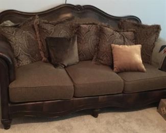 ANOTHER LARGE WOOD, LEATHER AND FABRIC SOFA