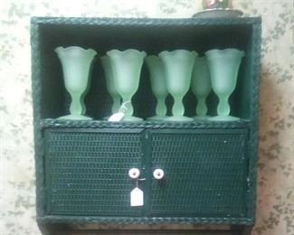 wicker shelf with green frosted glass