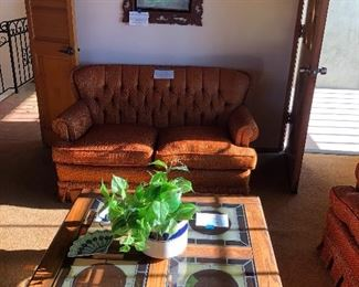 Pair of orange tweed sofas, (glass coffee table is sold) - there are other pieces that also have this!