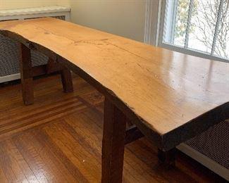 Custom-designed live edge table or desk.