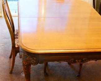 Berkey and Gay dining table includes 4 armless chairs, 3 leaves and custom table pads.