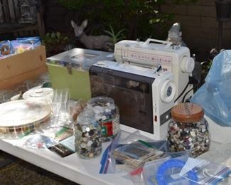 Sewing machines, buttons, thread and sewing basket