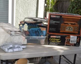 Vintage concert programs, albums and Crosley 5 in 1 entertainment center & stand (brand new ).