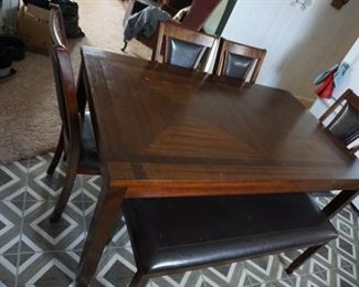 table with chairs, bench