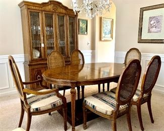 Heritage dining table includes 2 leaves and 8 cane backed chairs.   *there is also a matching china cabinet and sideboard*