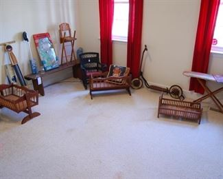 Toy room, antique scooter, doll beds, primitive bench