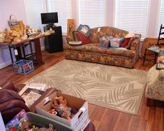 Downstairs sunroom-full of craft supplies, magazines and more