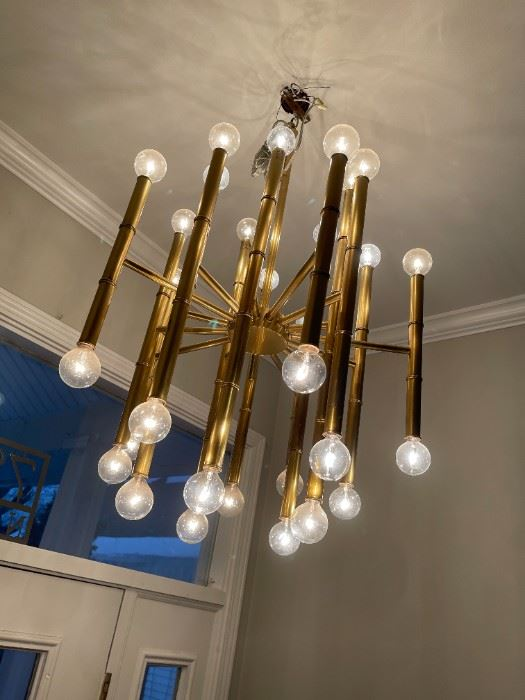 Lite up your life with this Johnathan Adler! Light bulbs included. It truly is a remarkable piece.