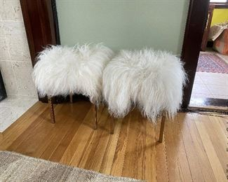 CB2 sheepskin footstools with brass legs
