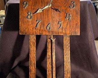 Mission oak wall clock with metal numbers and brass pendulum. Does chime but needs something fixed . No key - $75