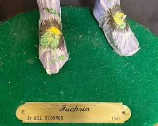 """Additional photo of fairy name plate. """"Fuchria"""" By Bill O'Connor, 1997."""