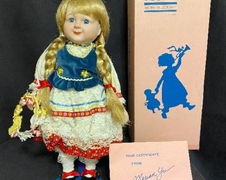 """Porcelain doll by """"Marian Yu Design Co"""" 1989 limited edition, has box and certificates. """"Gerta"""" measures 16"""" tall and in mint condition with stand. Marked with number  426/5000. $25"""