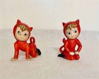 Vintage two little porcelain child like devil figurines. $18