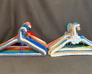 27 hand crocheted covered metal hangers.$18