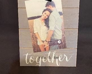Brand new wooden 4x6 photo frame with photo clip and frame stand on back side. $8