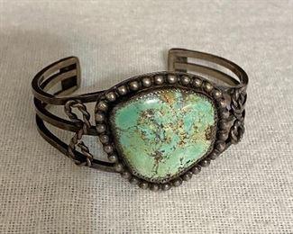 "Sterling silver and turquoise signed ""JM"" bracelet. $60"