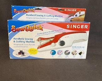 "Like new in box ""Singer"" Sew Quick machine. $10"