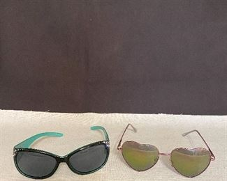 Pair of sunglasses. Turquoise/Black with jewels. (one jewel is missing), Metal frame glasses with heart shaped lens. Pair $12