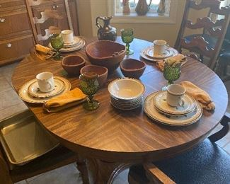 Our cool 70s dining table set with some awesome stoneware. In the center is a Monkey wood Salad set, straight out of the 60s! So Groovy!