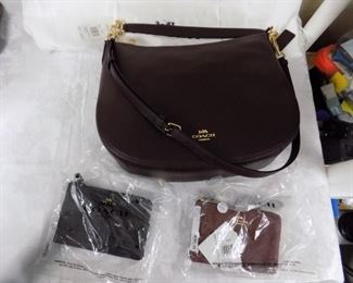 BRAND NEW COACH PURSE AND WALLETS.*WITH TAGS