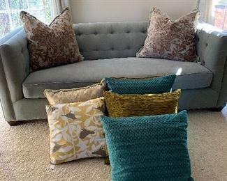 Seafoam Tufted Custom Sofa. Decorative Throw Pillows.