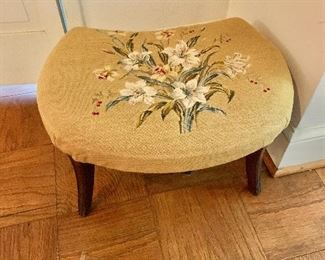 "$75 - Needlepoint footstool; AS IS, bottom liner is ripped, wear to the legs. 21"" W x 16"" D x 12"" H"