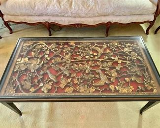 "$500 - Rectangular glass top Chinoiserie coffee table with an enclosed panel depicting birds and foliage.  Turned legs on brass feet and casters,  50.5"" W x 27"" D x 17"" H"
