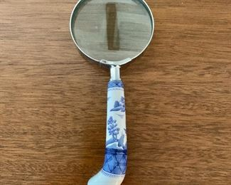 "$20 - Magnifying glass with blue and white handle; 7.5"" long"