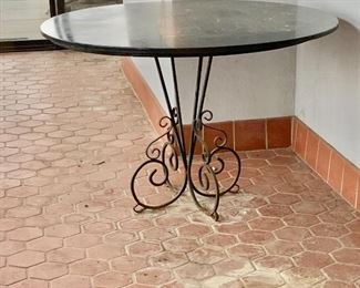 "$250 - Vintage table with black stone top and metal stand - AS IS - table is worn due to use and age -  46"" diameter, 30"" H"