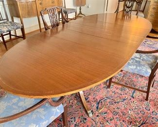 "$995 - Federal style double pedestal, inlay, banded dining table with brass cap feet- 8'7"" L with three 12"" leaves, approx 62"" without leaves - 45"" W x 30"" H"