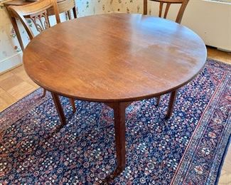 "$250 - Round table made by Copenhaver's Furniture, Winchester, Va.; AS IS, significant wear to finish. 44"" D x 30"" H"