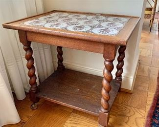 "$175 - Turned leg side table with tile top; AS IS, slight wobble due to one short leg. 24"" H x 19"" D x 25"" W"