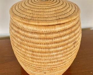 "$95 - Woven basket with carved stone bird on lid; 12"" H x 9"" W"