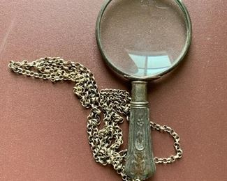 "$20 - Magnifying glass on a chain; 4"" long"