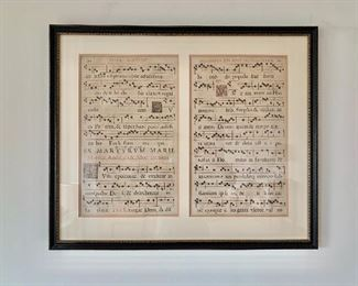"$150 -Two framed antique musical scores on parchment;  25"" H x 30"" W"