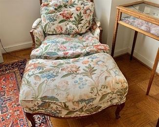 "$450 - Louis XV style Bergere chair and matching footstool;  feather filled cushion; AS IS,  fabric torn on ottoman. Chair 35"" H x 32"" W x 39"" D, seat height is approx 14"". Together the chair and ottoman are 62"" deep"