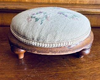 """$30 -  Needlepoint pincushion/ small footstool; 9"""" W x 4.5"""" H"""