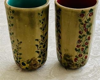"$40 - Set of 2 Ceramic hand painted tumblers; signed; 5"" (H) x 2.5"" (W)"