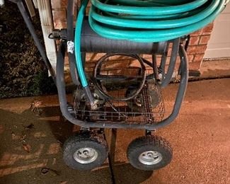 Large heavy duty rolling hose cart with like new hose $75 firm